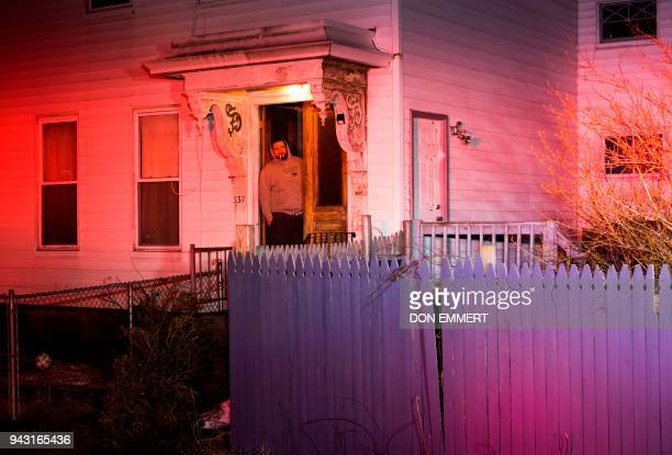 A man watches as firefighters respond to a neighbor's 911 call for an overdose March 28 2018 in Manchester New Hampshire Tucked away in the corner of...
