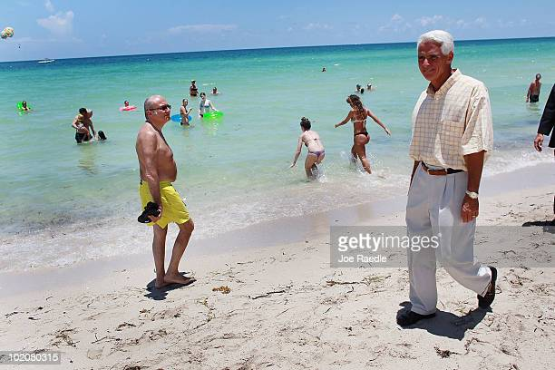 A Man Watches As Florida Gov Charlie Crist Is Followed By The Media He Claims