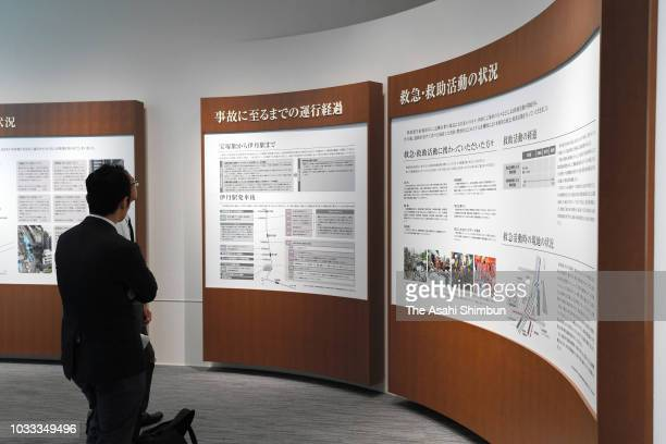 A man watches exhibits at the 'InorinoMori' memorial facility of the Amagasaki Train Crash on September 14 2018 in Amagasaki Hyogo Japan The worst...
