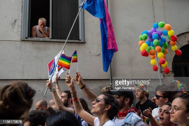 A man watches from a window the procession of LGBT activists during the Avellino Pride 2019 on June 15 2019 in Atripalda Italy Abellinum Pride 2019...