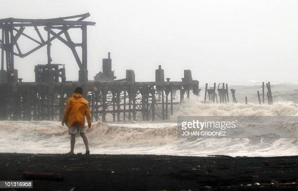 A man watches heavy swell on May 29 in Puerto San Jose Escuintla 110 kilometers south of Guatemala City The season's first tropical storm Agatha has...