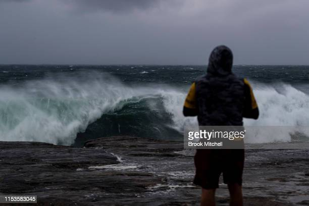 A man watches huge seas at Clovelley in Sydney's South on June 04 2019 in Sydney Australia The Bureau of Meteorology issued a severe weather warning...