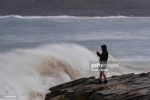 A man watches huge seas at Maroubra in Sydney's South on June 04 2019 in Sydney Australia The Bureau of Meteorology issued a severe weather warning...