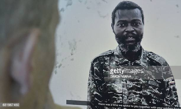 A man watches in Nairobi a video released by the AlQaeda linked Islamic extremists in Somalia showing a Ugandan soldier captured in September 2015...