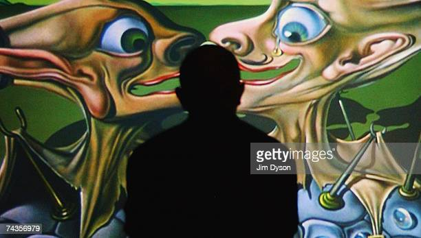 A man watches scenes from the Salvador Dali/Disney film 'Destino' at the Tate Modern on May 30 2007 in London The exhibition displays the...