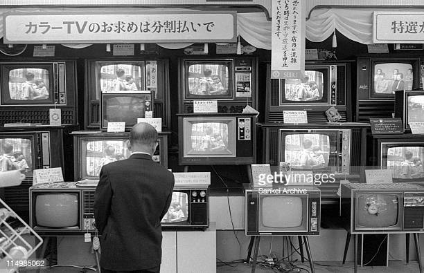 A man watches television sets at a consumerelectronic shop in December 1968 in Tokyo Japan