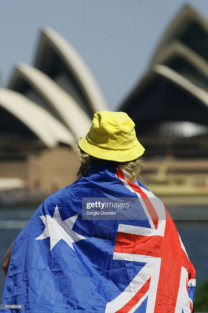 A man watches the Australia Day celebrations on Sydney Harbour on January 26, 2008 in Sydney, Australia.