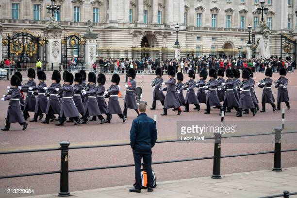 Man watches the Changing of the Guard ceremony outside Buckingham Palace on the day that Queen Elizabeth II is set to move to Windsor Palace in a bid...