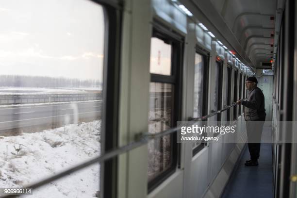A man watches the landscape as she travels with the Eastern Express which travels from Ankara to Kars in Kars Turkey on January 13 2018 With the...