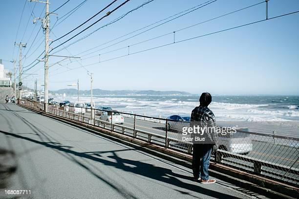 Man watches the ocean near Enoshima, Japan