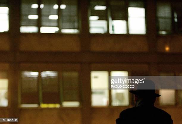 Man watches the Policlinico Gemelli hospital where Pope John Paul II is hospitalized 09 February 2005. Vatican spokesman Joaquin Navarro-Valls raised...