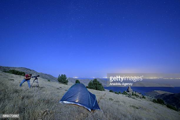 A man watches the sky during the annual Perseid meteor shower near St Thomas Monastery in Gevas district of Van Turkey on August 13 2016