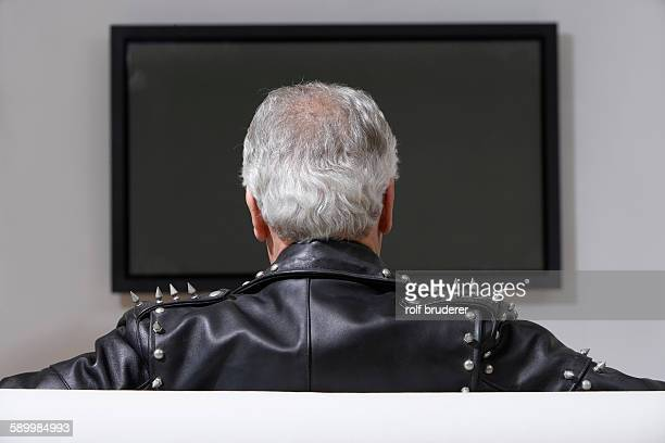 Man Watching a Blank Television