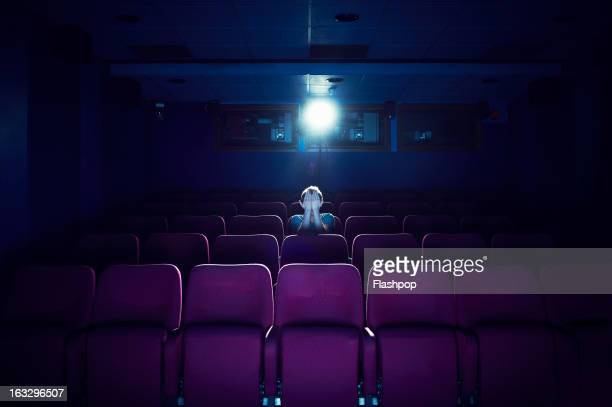 man watching a movie in empty cinema - spectator stock pictures, royalty-free photos & images