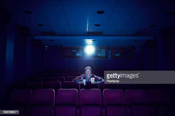 man watching a movie in empty cinema - indústria cinematográfica - fotografias e filmes do acervo