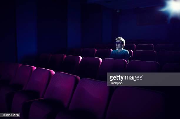 Man watching a movie in empty cinema