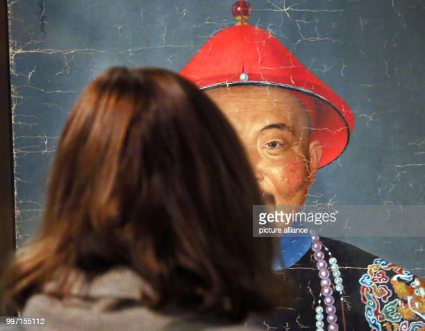 A man watching a portrait painting from China by an unknown artist in the Kulturforum at the Matthaikirchplatz in Berlin Germany 10 October 2017 The...