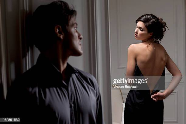 A man watching a young woman undressing
