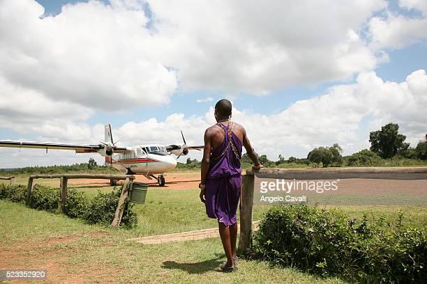 Man Watching Airplane