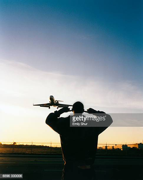 man watching airplane - fingers in ears stock pictures, royalty-free photos & images