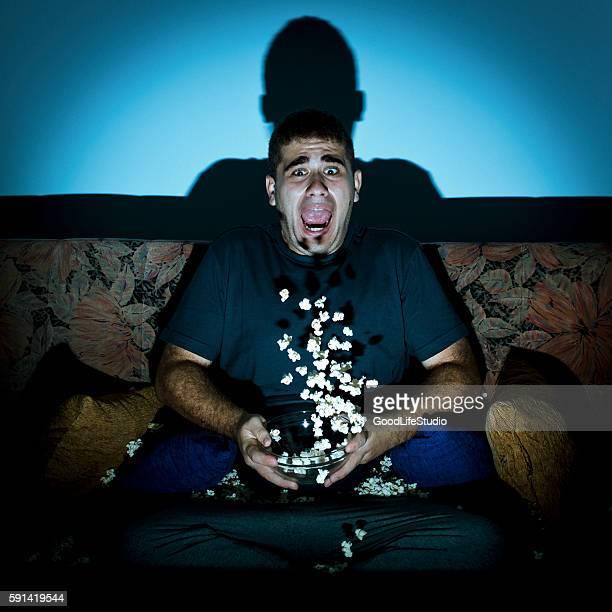 Man watching horror movie