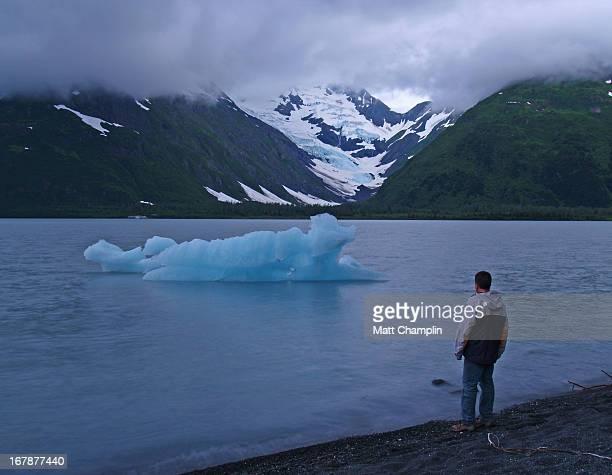 Man watching iceberg on Portage Lake, Alaska