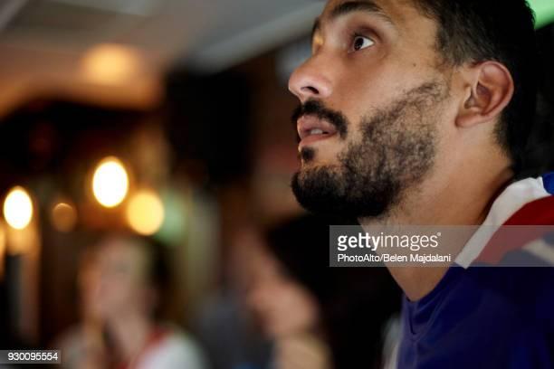 Man watching sports match in bar