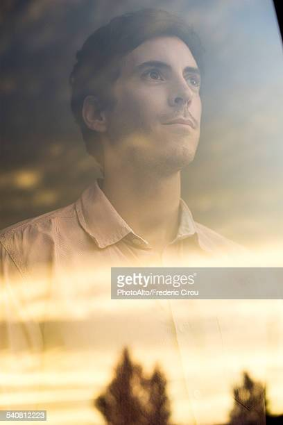 Man watching sunrise with optimstic outlook