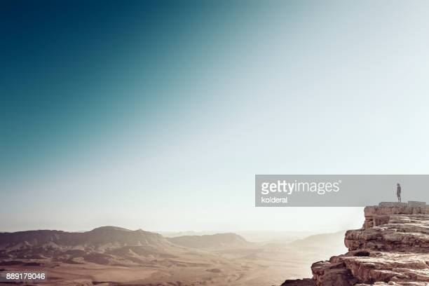 Man watching sunset above desert landscape