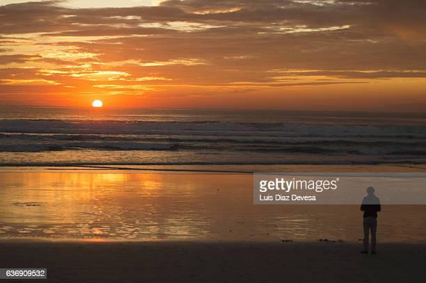 Man watching sunset at beach