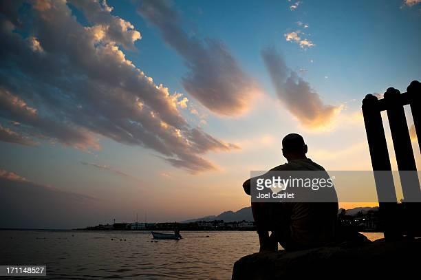 Man watching sunset in Dahab, Sinai, Egypt