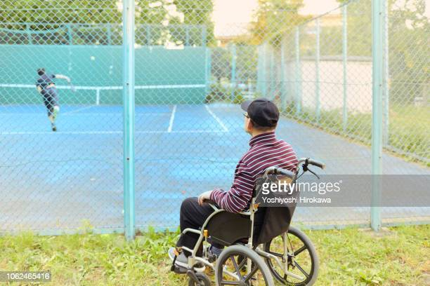 Man watching tennis on wheelchair