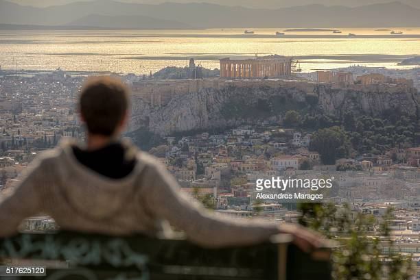 Man watching the Acropolis of Athens, Greece