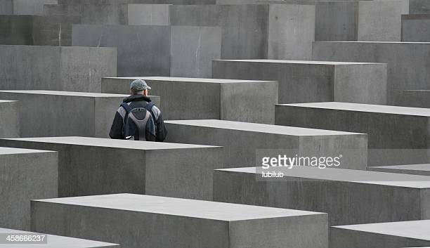 Man watching the Holocaust Memorial in Berlin, Germany