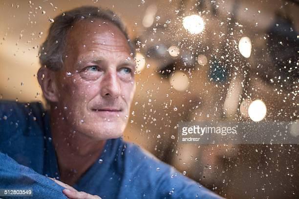 Man watching the rain