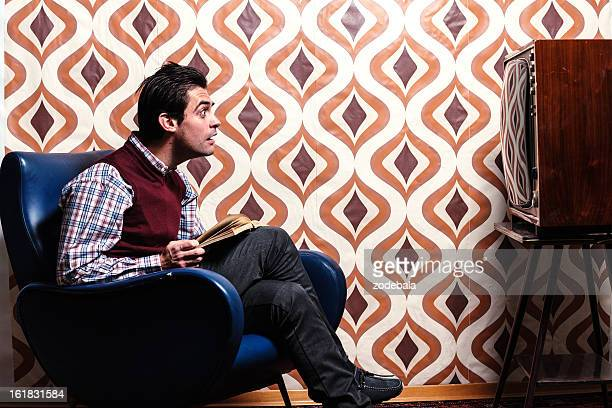 Man Watching the TV in Retro Room with Surprised Expression