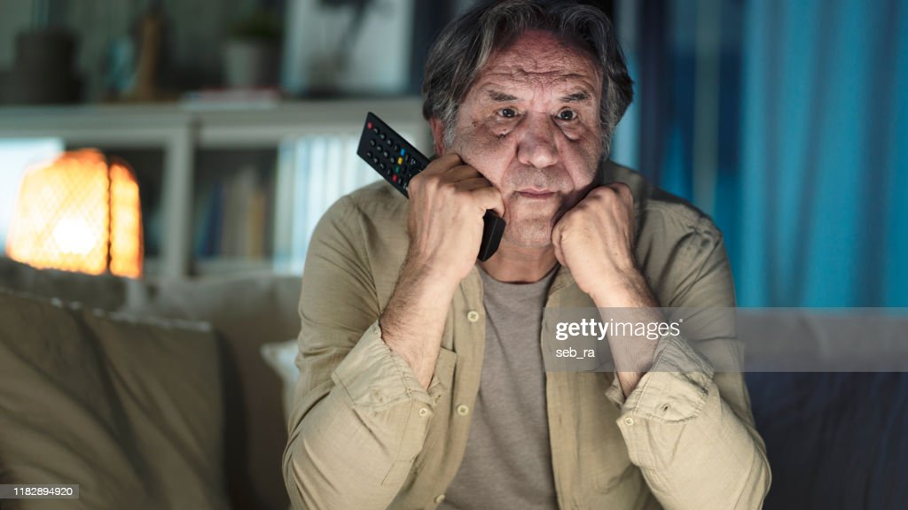 Man watching tv at home : Stock Photo