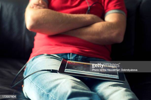 Man watching TV on digital tablet