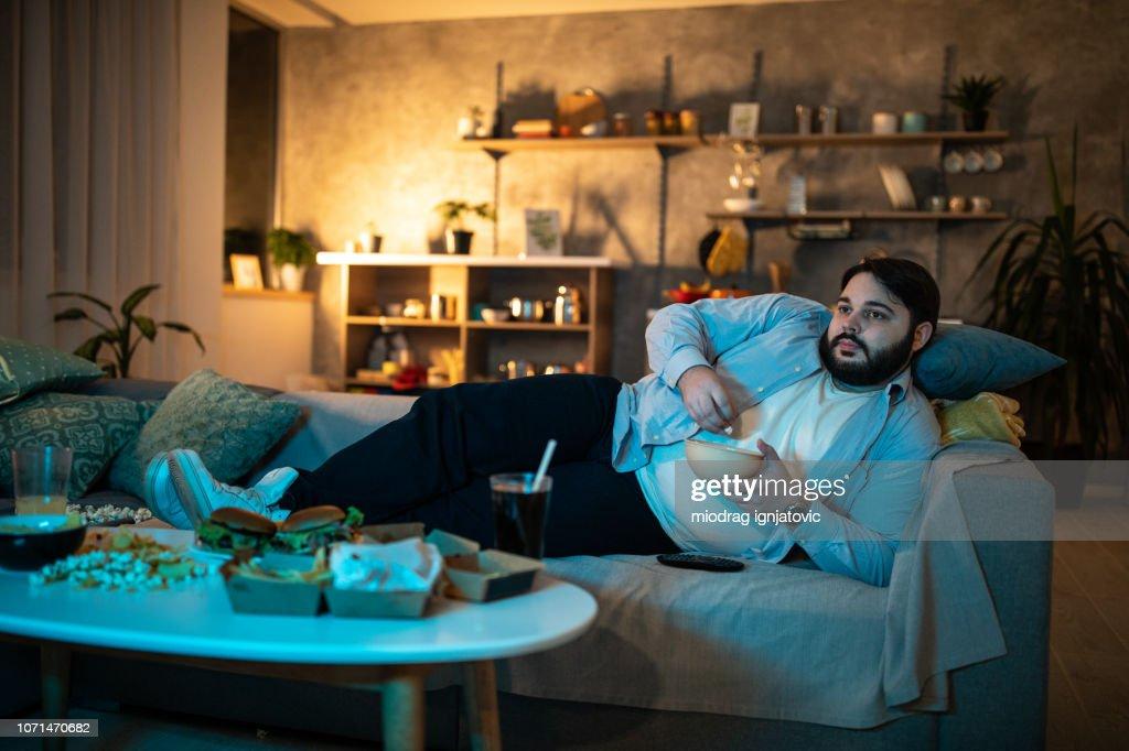 Man watching TV show : Stock Photo