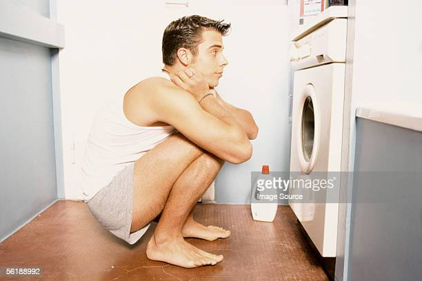 Man watching washing machine