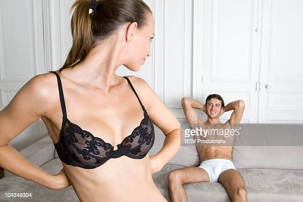 Man watching woman undress