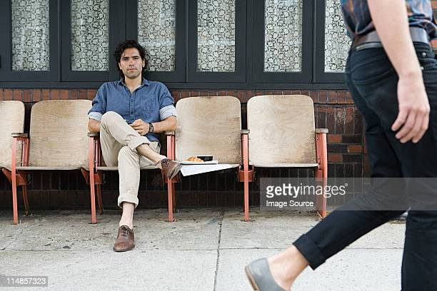 man watching woman walk by - moving past stock photos and pictures