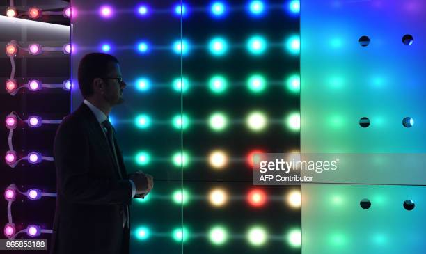 A man watchs a LED light installation during the opening of Osram's showroom space named 'World of Light' at the headquarters of the German light...