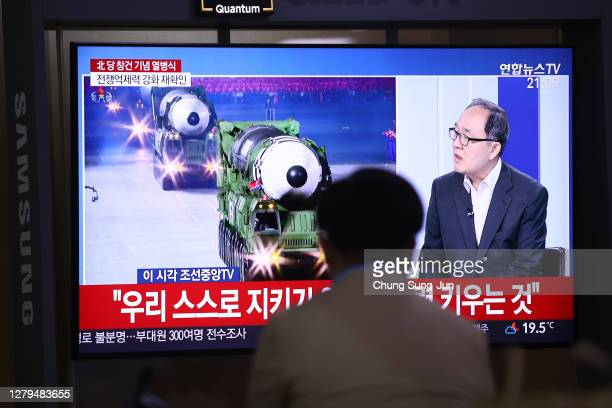 Man watchs a television show North Korea ruling party's founding 75th anniversary day military parade released by Korean Central News Agency at the...