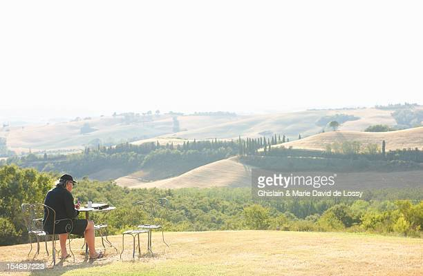Man watercolor painting Tuscan countryside scenery