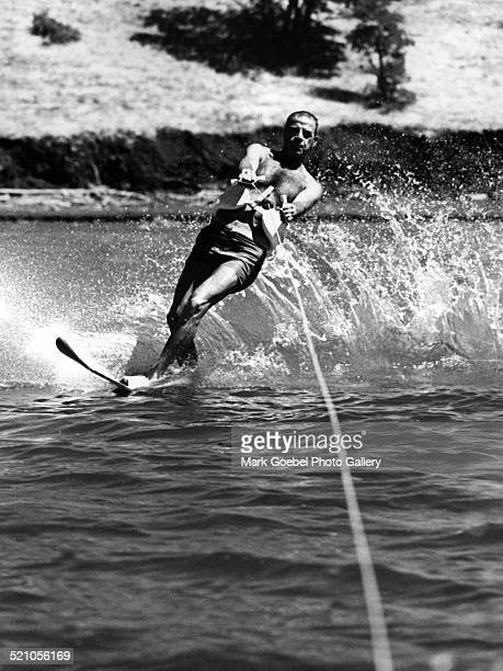 Man waterskiing on lake, late 1960s.