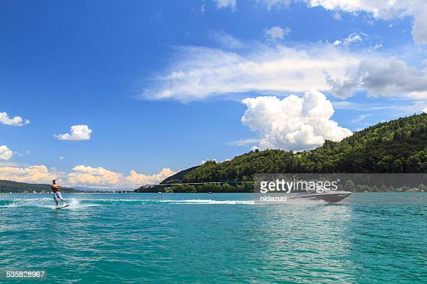 man waterskiing, worthersee, austria - waterskiing stock photos and pictures