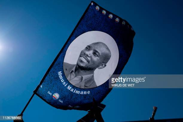 Man waves a banner with a picture of Democratic Alliance Leader Mmusi Maimane, at the South African opposition political party, Democratic Alliance...