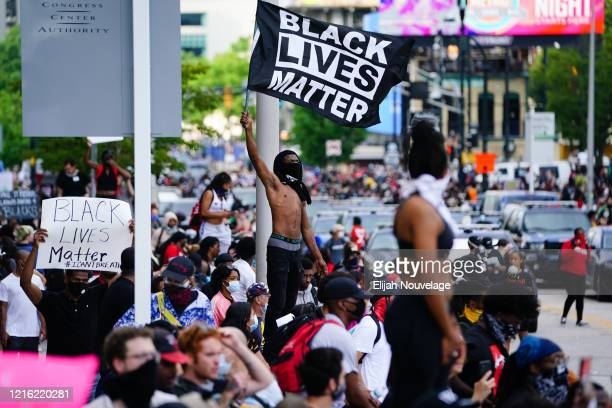 A man waves a Black Lives Matter flag during a protest on May 29 2020 in Atlanta Georgia Demonstrations are being held across the US after George...
