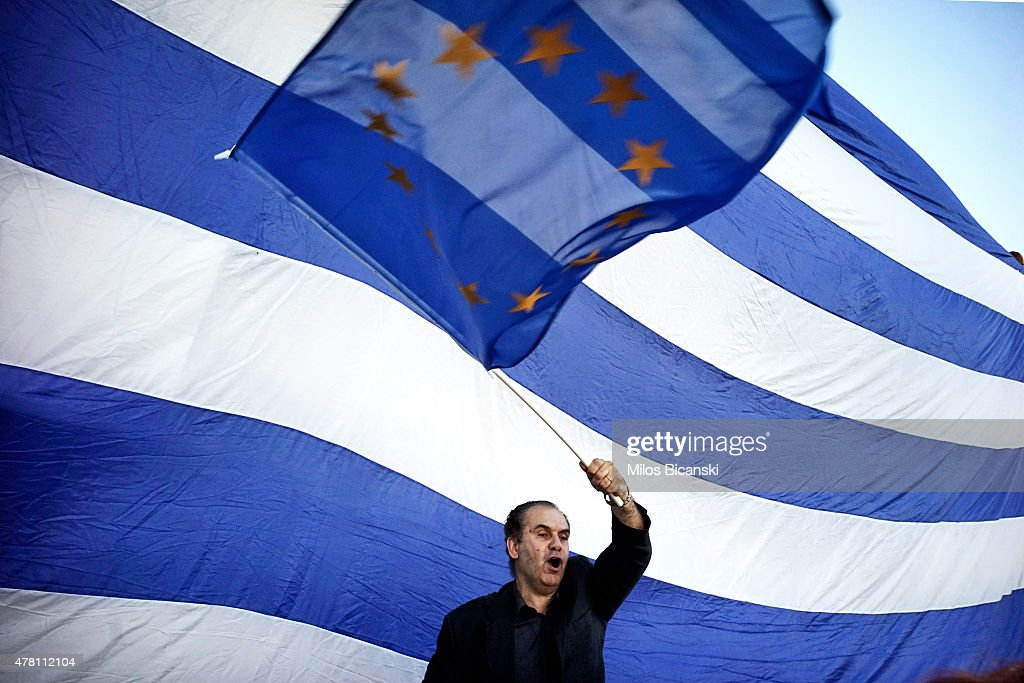 A man waves a EU flag as pro-Euro protesters take part in a rally in front of the Parliament on June 22. 2015 in Athens, Greece. Thousends of people attended the rally in support of Greece remaining in the European Union. The Eurozone's 19 national leaders held an emergency summit in Brussels to discuss the crisis and welcomed new proposals from the Greek government after talks today to haul Athens back from the brink of bankruptcy.